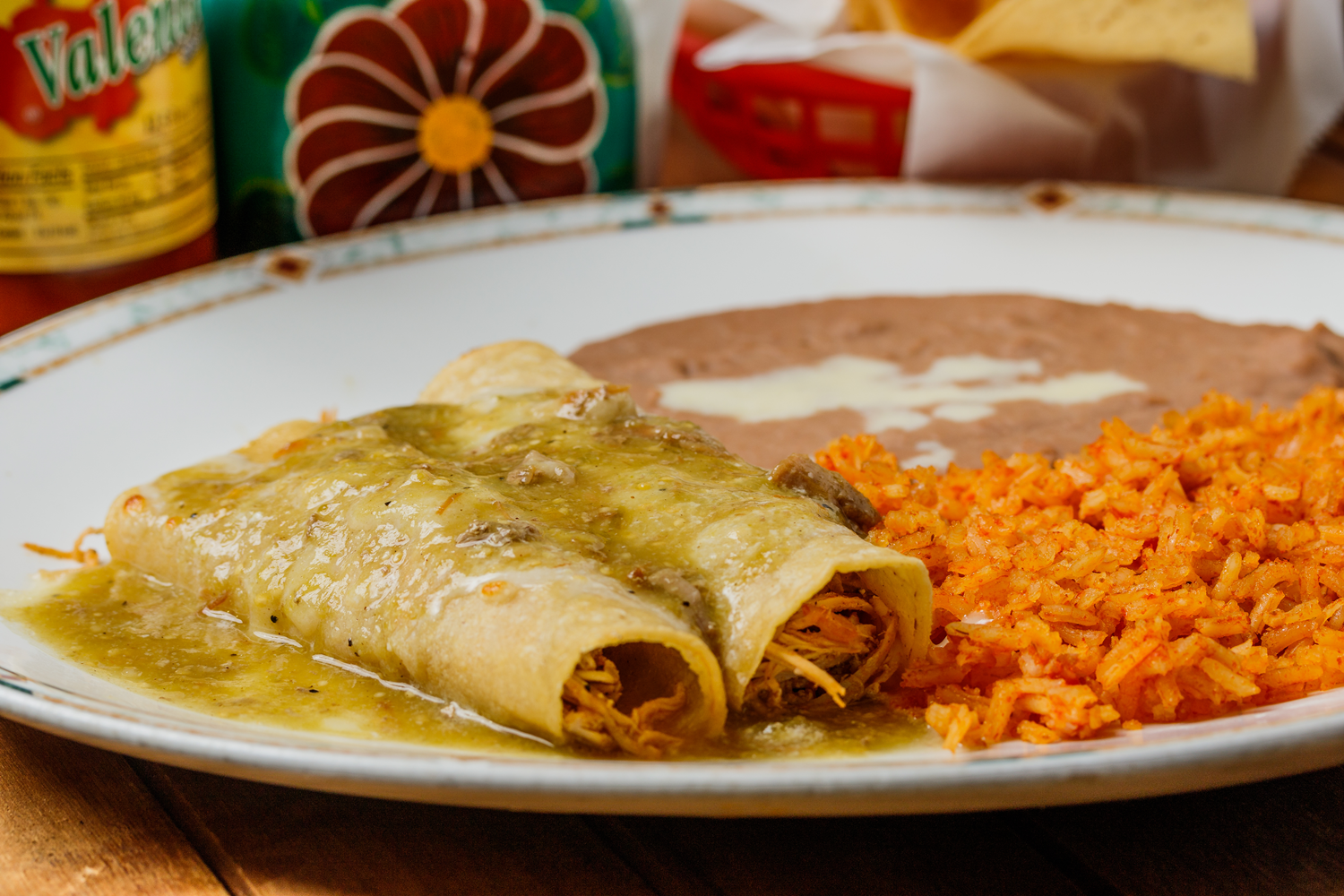 green enchiladas rice and refried beans